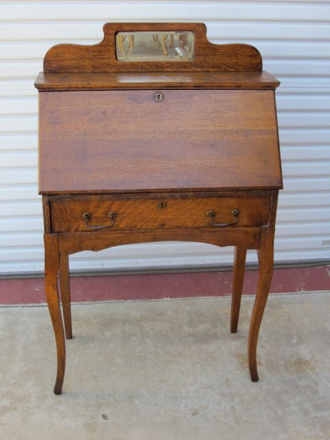 This is a charming original American antique breakfront secretary desk that  is made out of oak - This Is A Charming Original American Antique Breakfront Secretary
