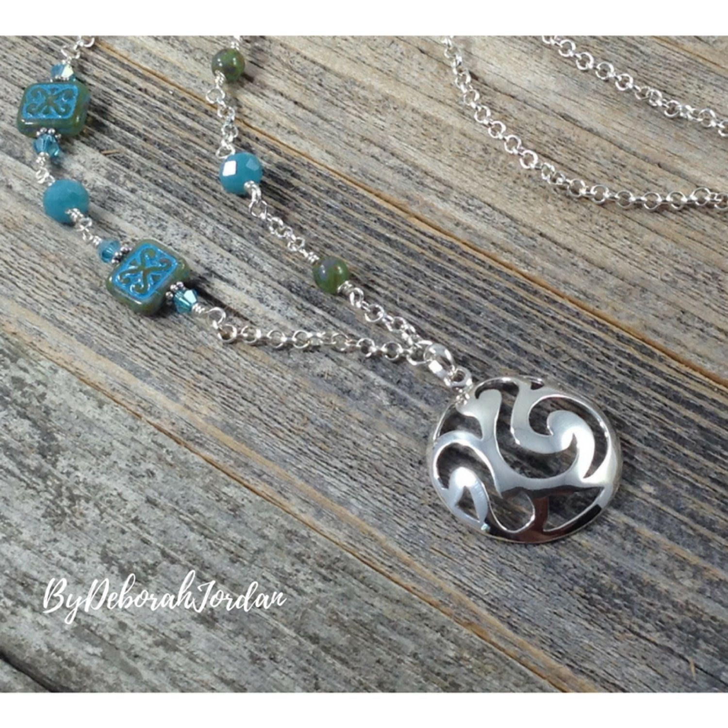 A personal favorite from my Etsy shop https://www.etsy.com/listing/527240904/sterling-silver-pendant-necklace-aqua