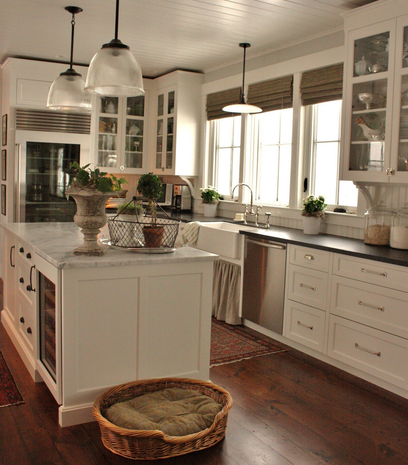 Lovely Farmhouse Kitchen Floor Ideas Part - 9: White Kitchen With Dark Countertops And Glass Cabinet Doors. Marble  Countertop On Island. Beadboard Ceiling And Wood Floors.
