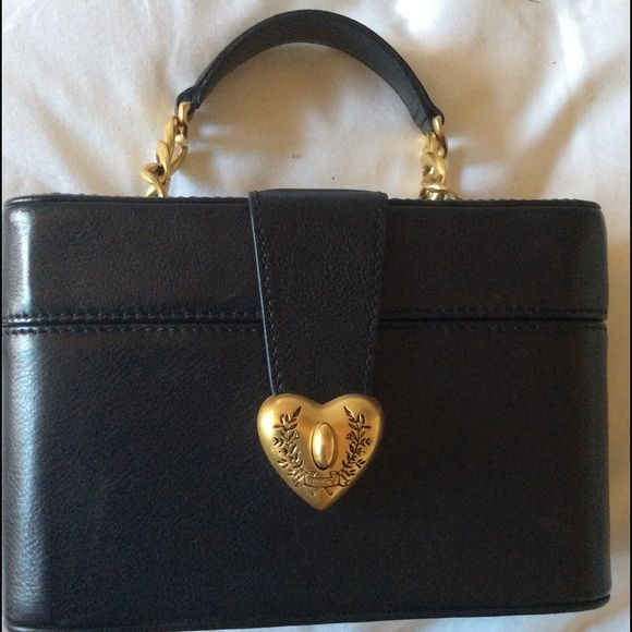 """Juicy couture black leather handbag Adorable Juicy Couture black leather box style handbag with gold hardware trim, gold chain enhanced handle. Heart shaped latch close. 1 interior pocket. Signature JC interior pink lining. 8"""" long, 5 """"high, 4"""" wide. Juicy Couture Bags"""