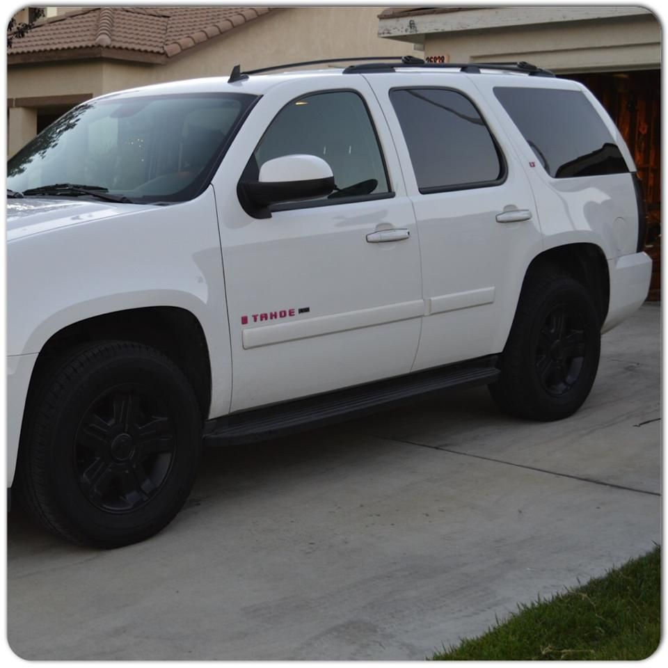 White Tahoe With Pink Emblems, Black Rims, And Taillights