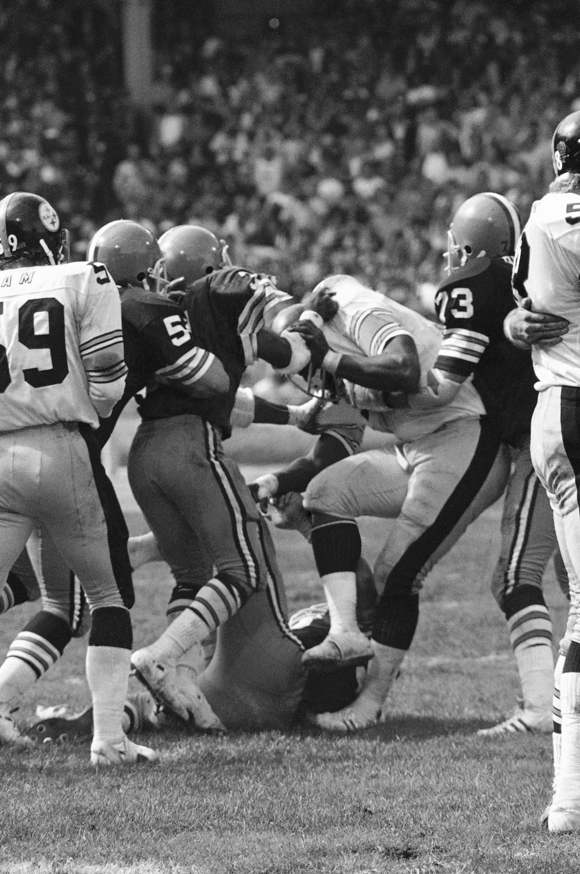 26b5a1c1d70 Pittsburgh Steelers' defensive tackle Mean Joe Greene kicks Cleveland  Browns' guard Bob McKay in the groin
