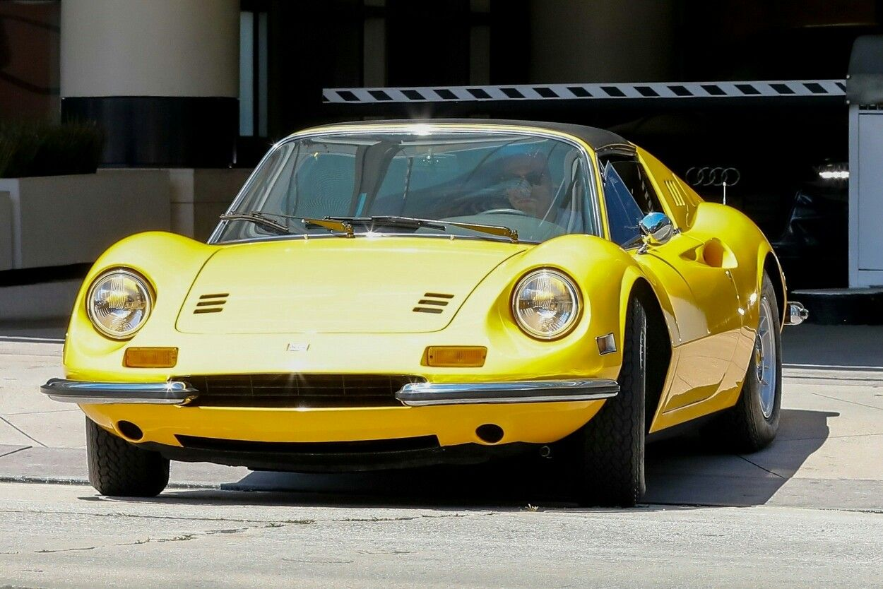 Harry Was Driving A Classic 1972 Ferrari Dino 246 Gt In Yellow In La On 12th July Cute Cars Yellow Car Harry Styles
