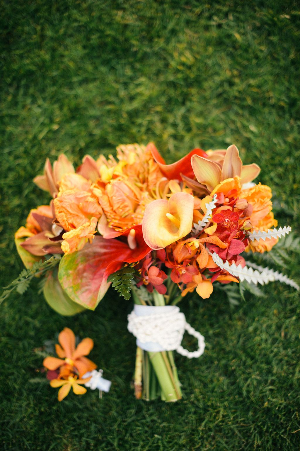Orange and red wedding bouquet beach wedding floral arrangements orange and red wedding bouquet beach wedding floral arrangements tropical wedding tropical flowers hawaii wedding bright wedding bouquet izmirmasajfo