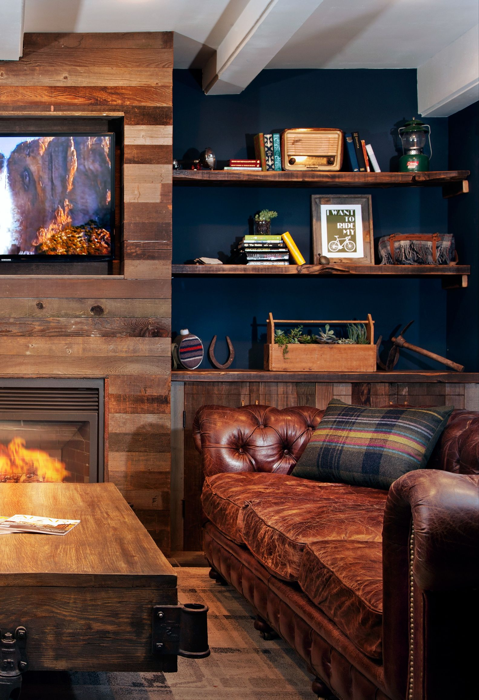 Snuggle Up On A Leather Couch By The Fireplace In Rustic Chic Lobby
