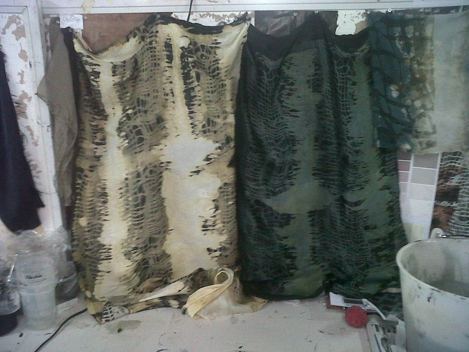 Hand printed textiles by myself, using screens and discharge to create a decomposing affect