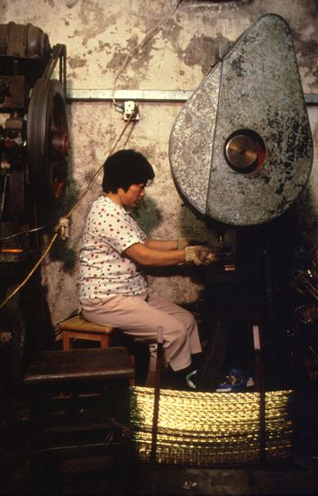 Greg Girard, Kowloon Walled City, Metal Stamp Machine Worker, 1989