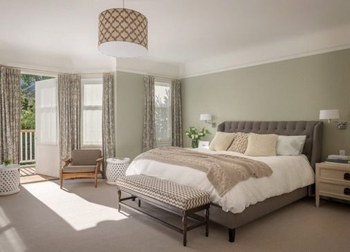 calm and warm wall colors with soft carpets in small bedroom