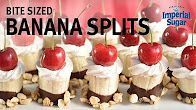 Bite sized banana splits - When you just want a little something sweet, but don't have the time to bake, here's your go-to treat. These Bite Sized fruit sweet treats are dipped in chocolate and candied macadamia nuts. They make a great dessert for spring and summer picnics and parties - especially for the Fourth of July, Labor Day or Memorial Day. They are fun to bring to a potluck or school celebration or serve as a cute after school snack. #labordaydesserts