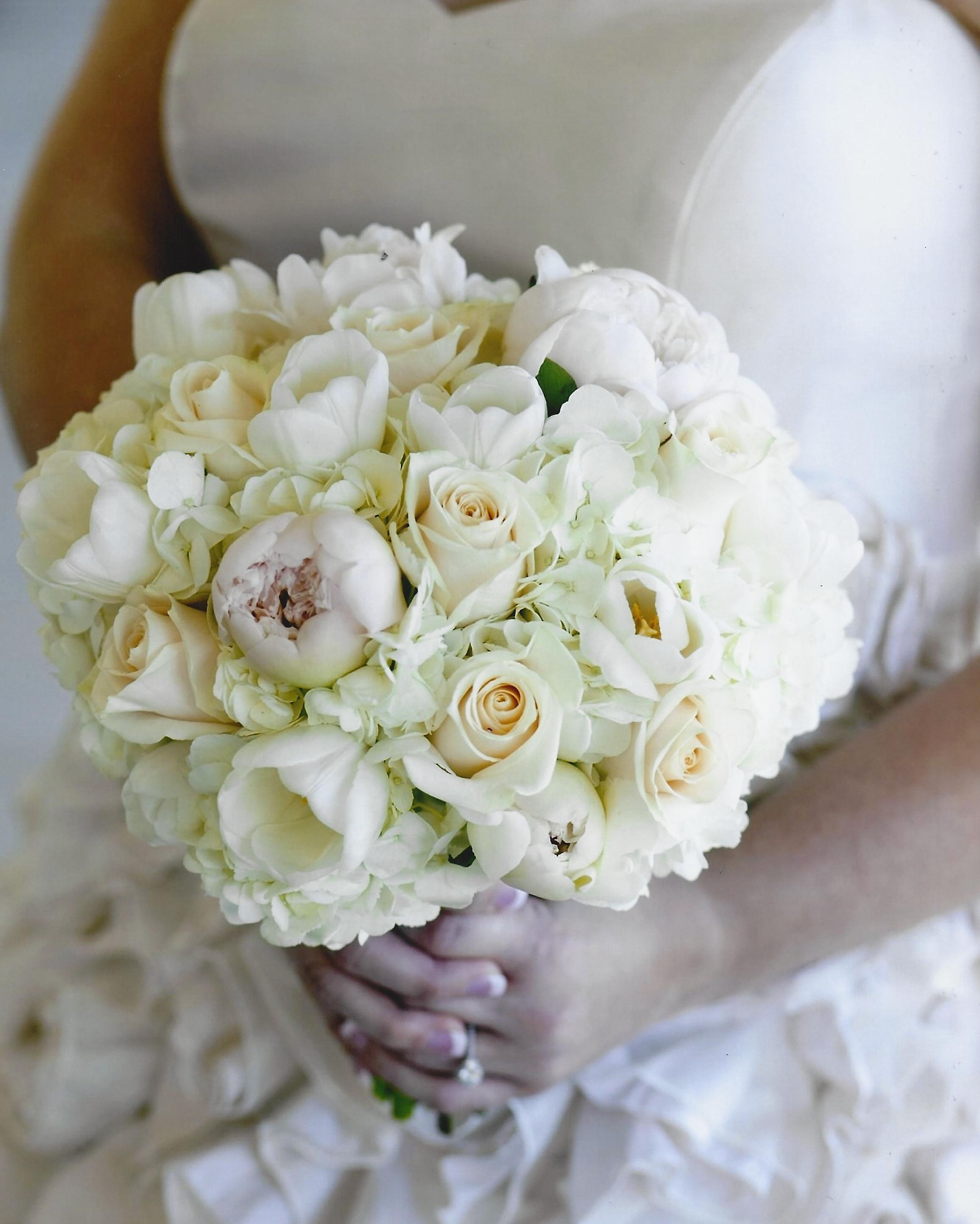 creamy vendela roses white hydrangea white tulips and barely blush peonies