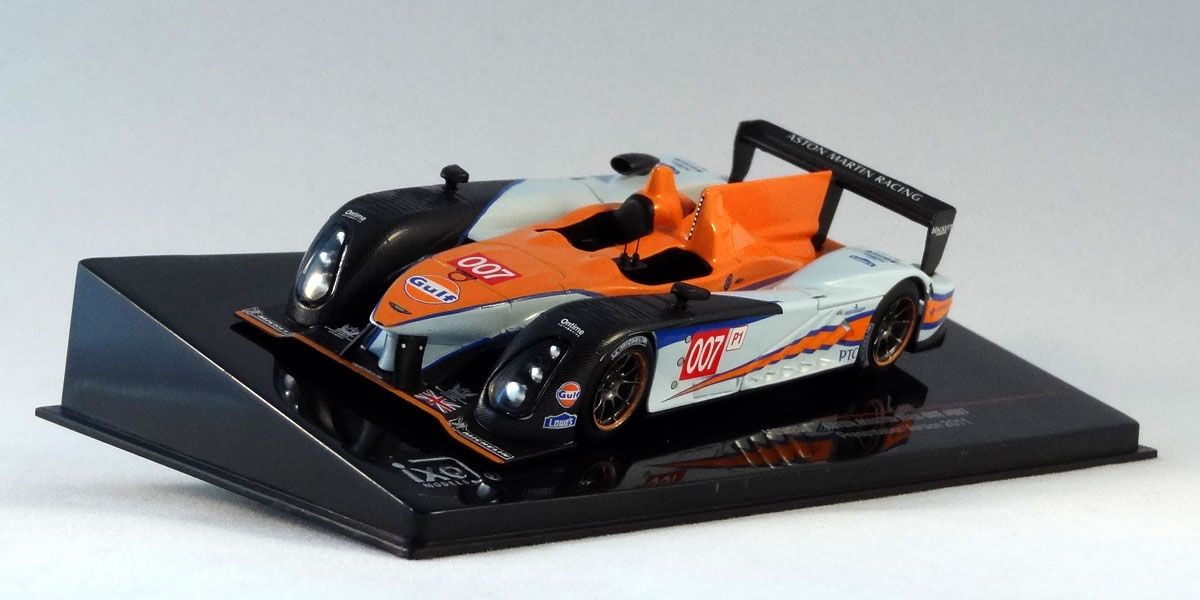 Ixo LMM200 Aston Martin AMR-One #007 Presentation Version 2011. 1:43 scale. Diecast with plastic parts. New in perspex box on plinth. The Aston Martin AMR-One was a Le Mans Prototype sports car built by Prodrive's Aston Martin Racing arm. Unlike their diesel competitors, Aston Martin had opted for an open-top Le Mans prototype.  Visit http://thegeniescave.co.uk/product-category/diecast/ixo/