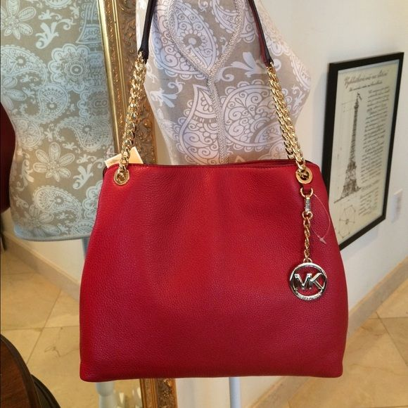 1000d22bb554da Michael Kors Jet Set Chain Leather Shoulder Bag Authentic red leather Chain  shoulder tote from Michael Kors. Hanging logo charm is detachable. Medium  sized.