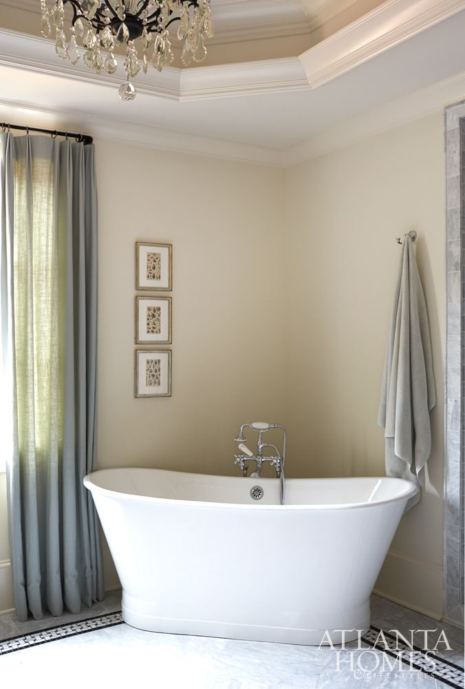 A Skirted Tub By Sunrise Specialty Is Placed In The Corner Of Master Bath So