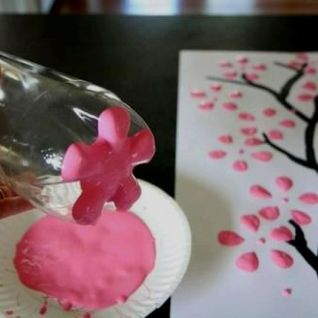 Cherry blossoms from a 2L soda bottle. Brilliant!  Great for a girls room.