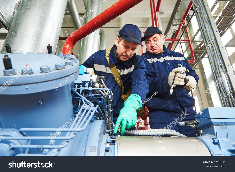 service engineer worker at industrial compressor