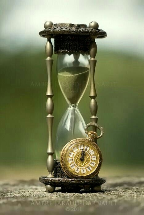 The Hourglass Symbolizes The Eternal Passage Of Time And Is A