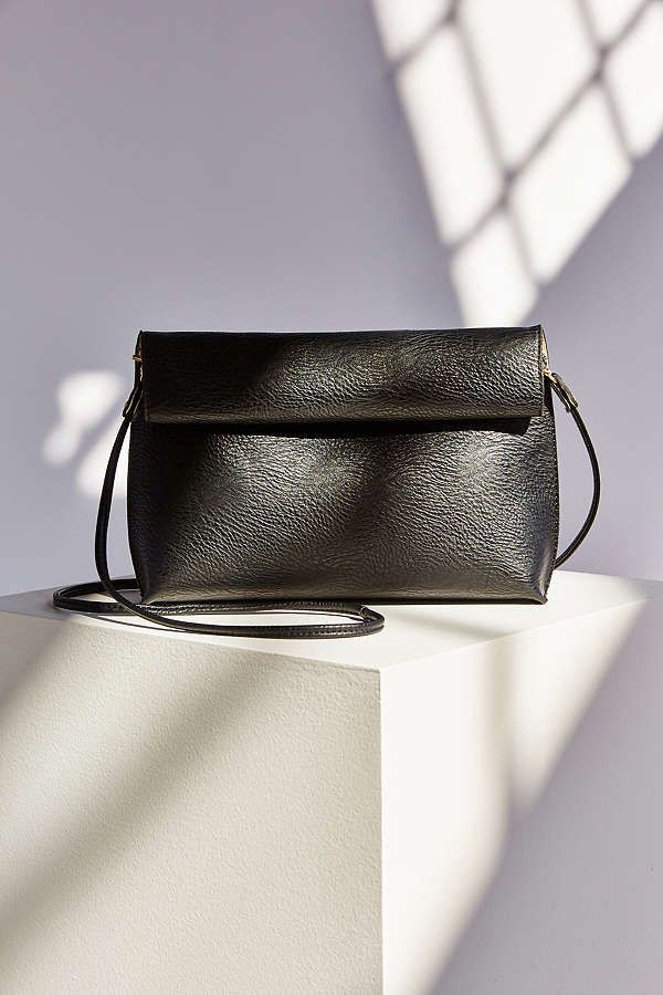 Shop Silence + Noise Roll Clutch Crossbody Bag at Urban Outfitters today.  We carry all the latest styles 8449c1b18e64d