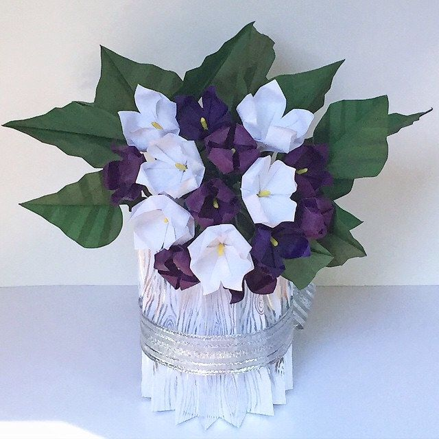 Flower bouquet with white and purple flowers in paper vase | NLM ...