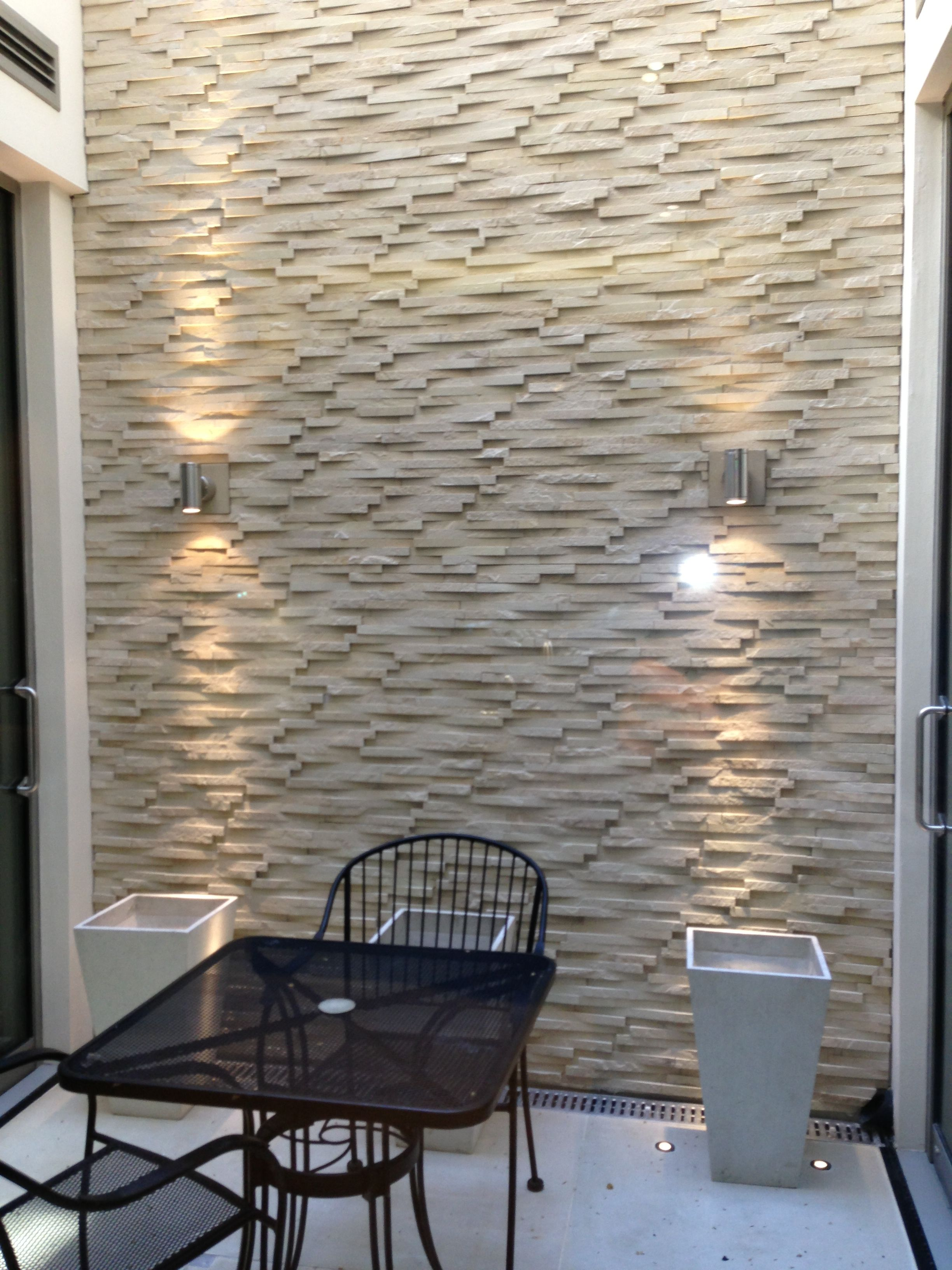 Relaxing Outdoor Space With A Limestone Accent Wall Limestone