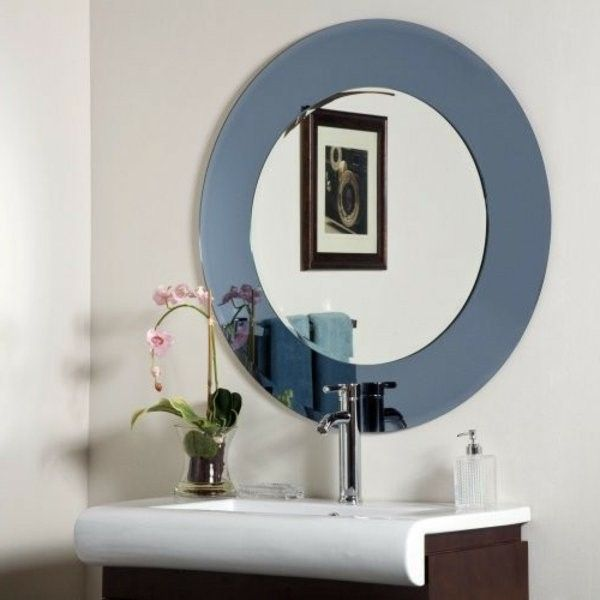 interesting bathroom with a designer bathroom mirror ...