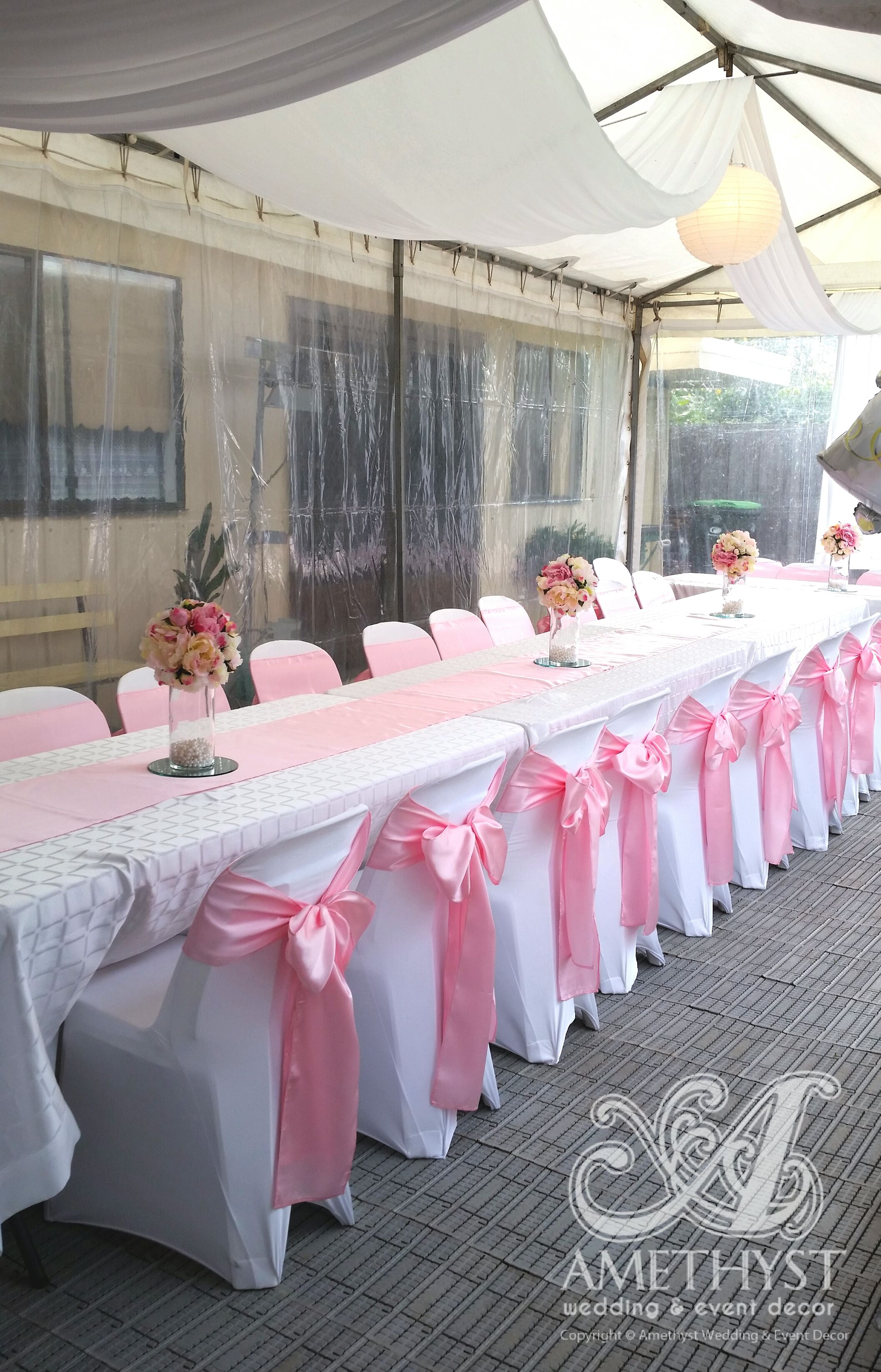 white chair covers and pink lace sashes and hessian table runners