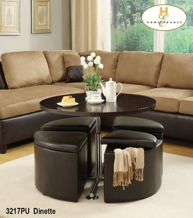 Coffee table doubles up as a dinette! Seats have storage and double ...