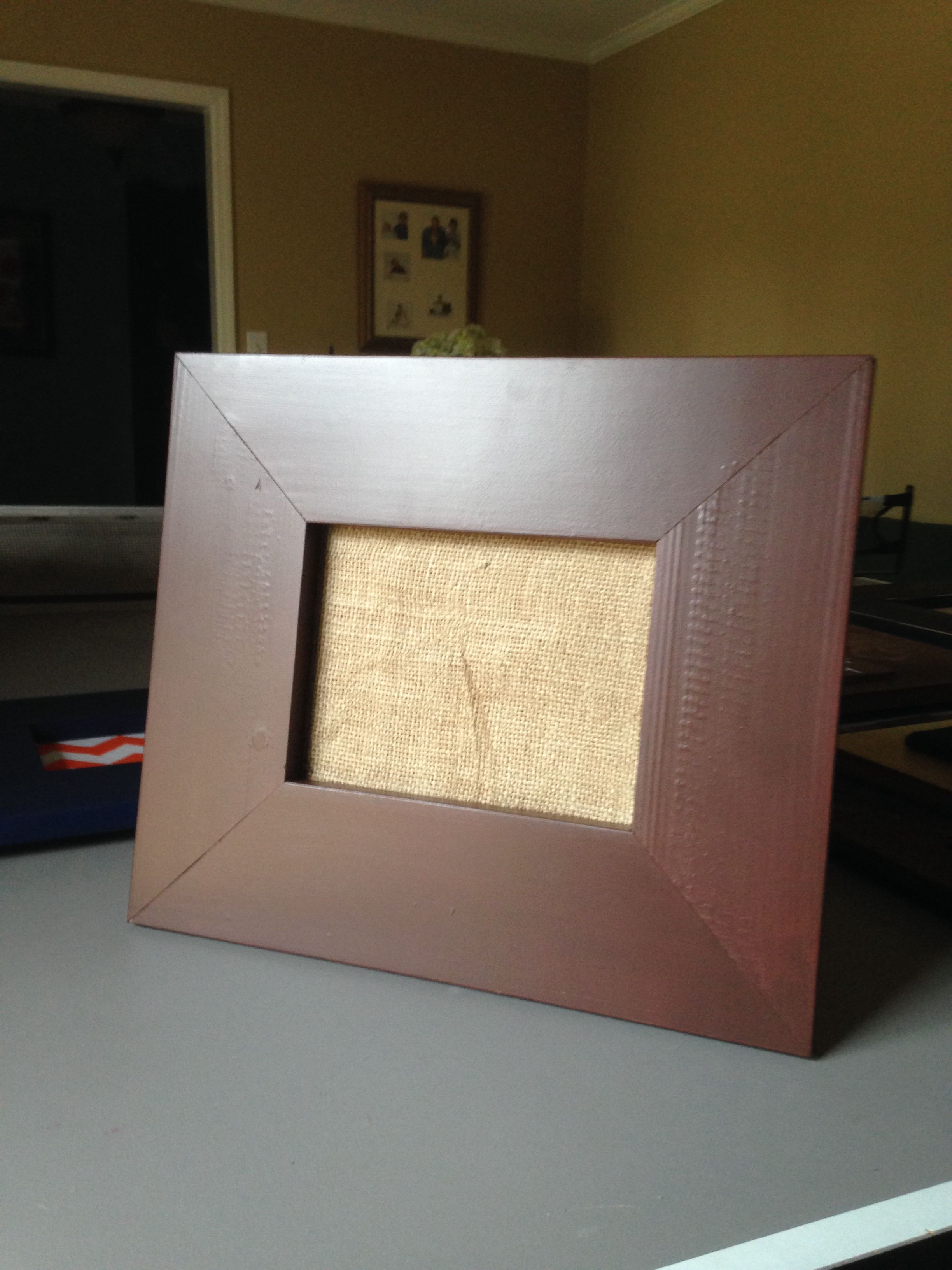 Chalk board frame with burlap covering cork so you can pin your pictures.