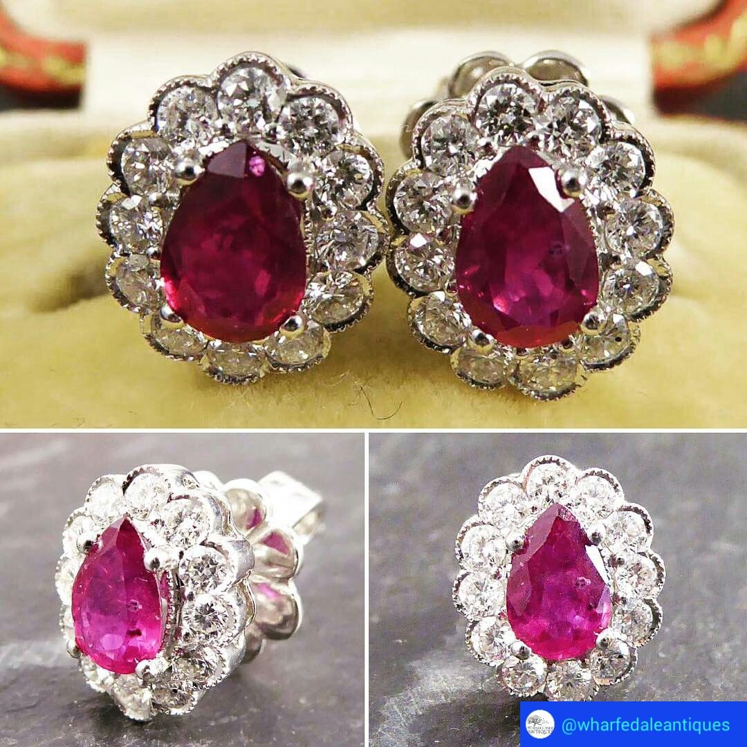 @wharfedaleantiques. These radiant Contemporary Earrings each feature a single pear-cut Ruby surrounded by twelve diamonds. They are crafted in 18ct White Gold #ruby #rubyred #cluster #earrings