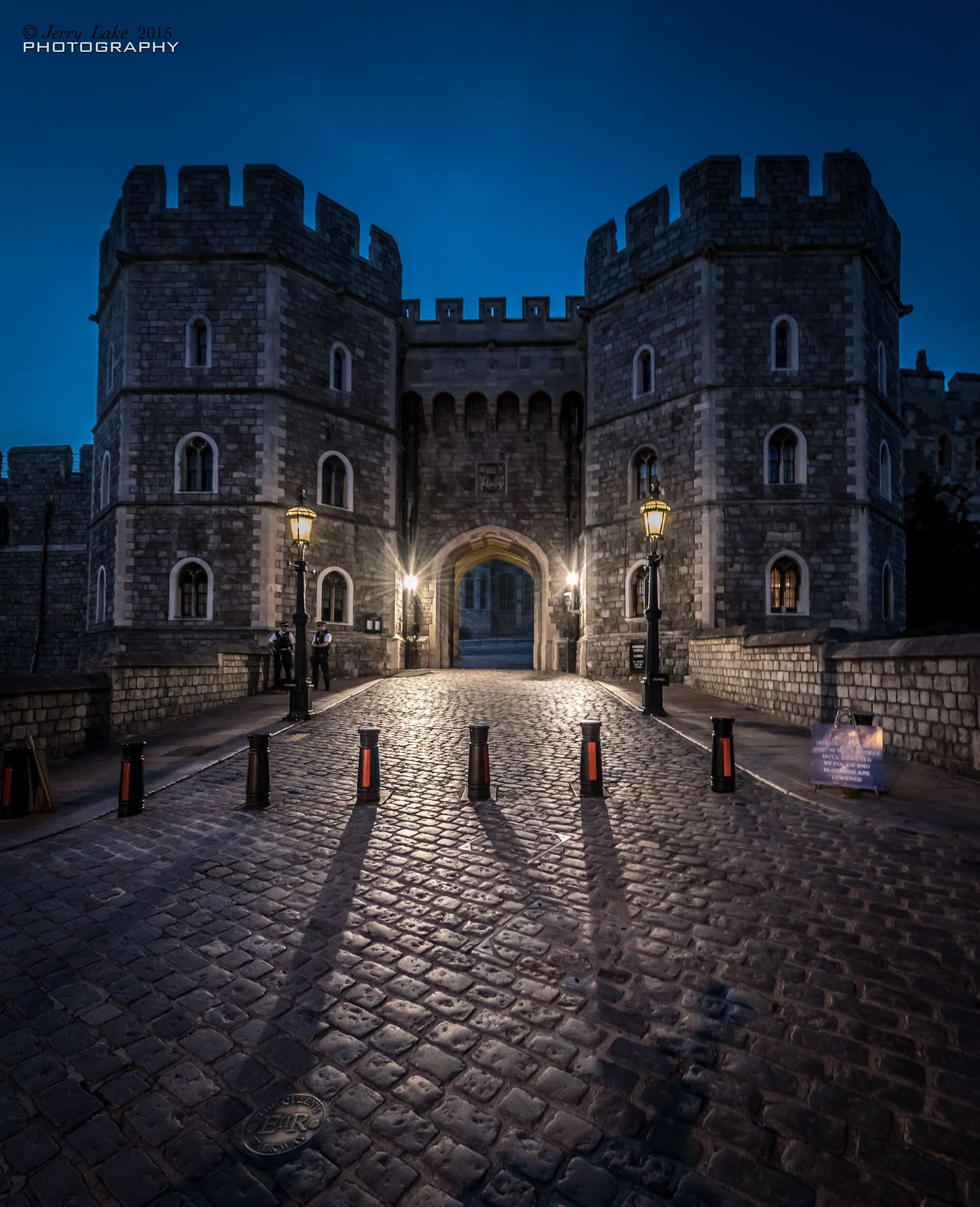 https://flic.kr/p/LwnFJF | Henry VIII Gate Windsor Castle {Explore} | Evening shoot with camera club to Windsor. In the foreground is one of 63 foot-way plates that are dotted around Windsor. (Camera info - handheld, ISO 2800 {auto-iso} f/6.3, shutter 1/15 second, focal length 15mm no flash.)
