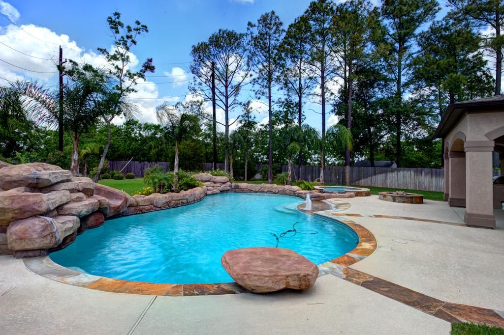 Love The Big Rock Diving Board Backyard Landscaping Designs