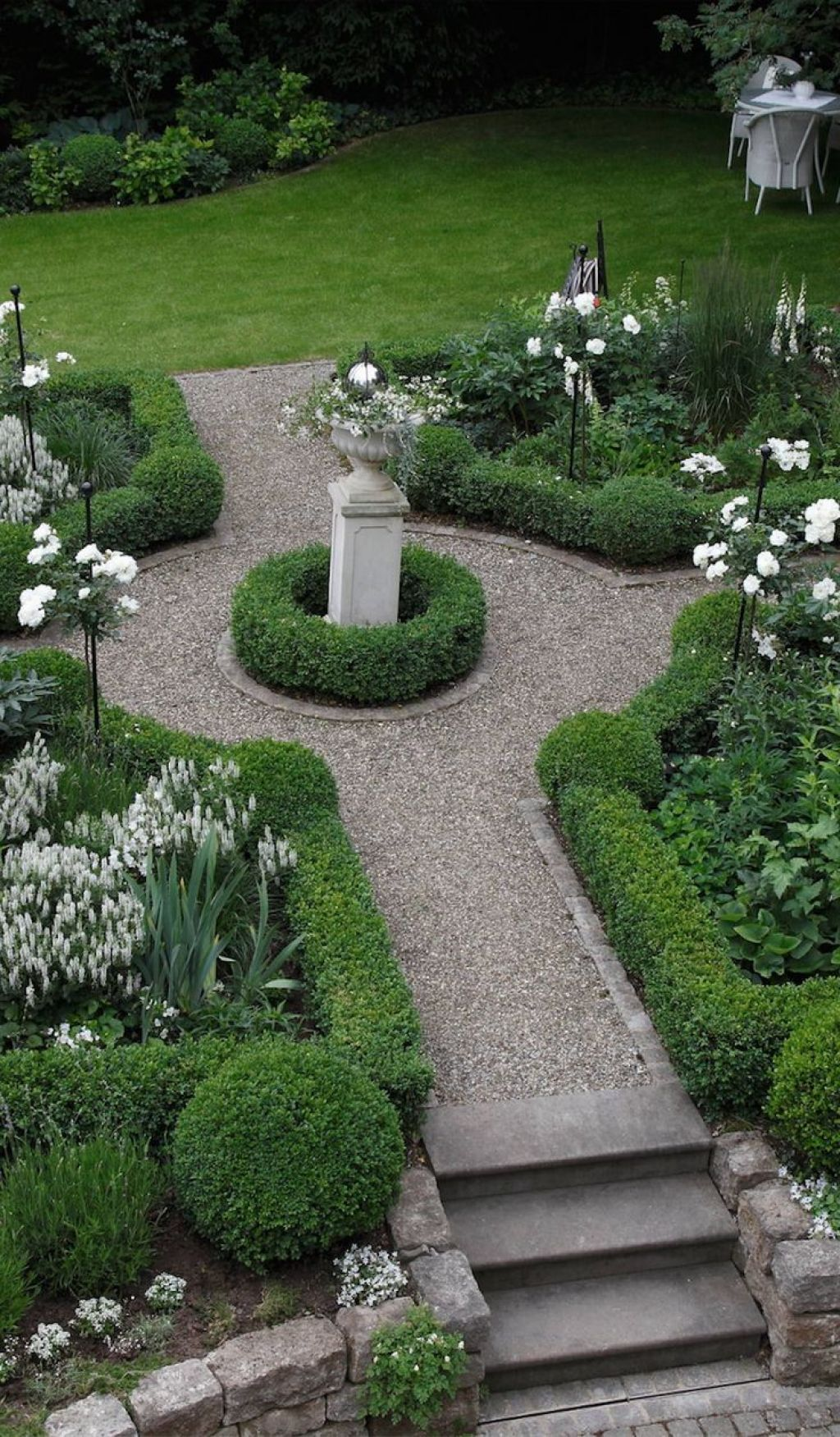 Formal garden with boxwood plants and urn boxwood plant for Front garden plant ideas