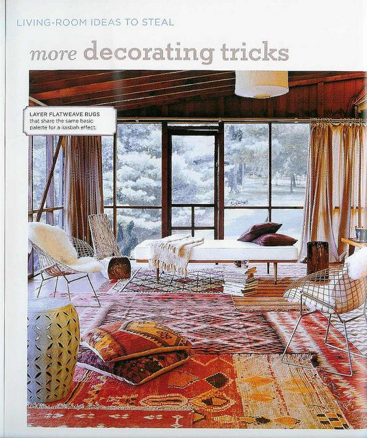 Layering Rugs Is Easy These Layered Flatweave Rugs In Tribal Prints Share The Same Colours And Styles Making A Chic Patch Sleeping Porch House Interior Home