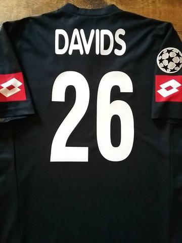 d185872d9b3 Relive Edgar Davids  2001 2002 Champions League with this original Lotto Juventus  away football shirt.