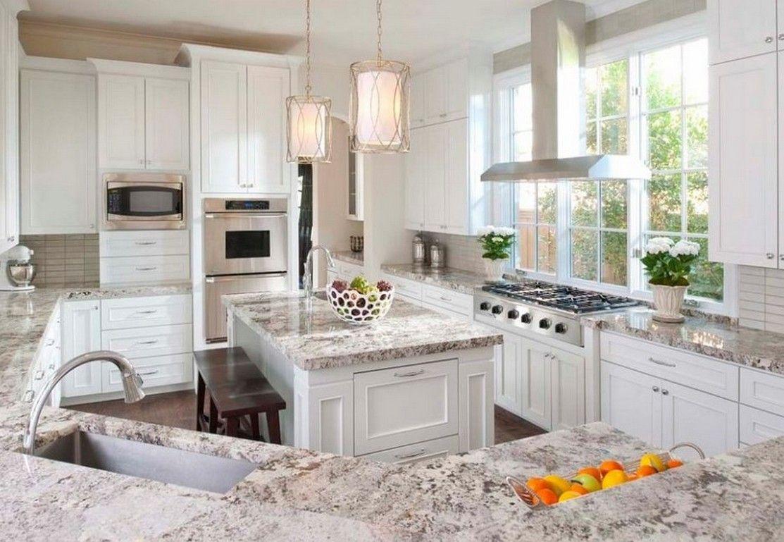 Giallo Ornamental Light Granite With White Cabinets