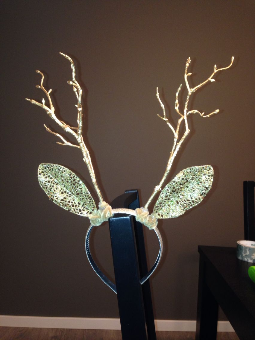 DIY deer antlers. Made from a headband, decorative flowers from michaels (twigs as antlers & leaves as ears) pipecleaners & a hot glue gun.