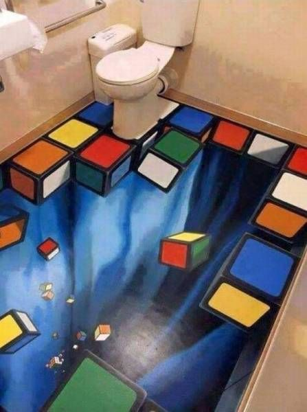 Trippy bathroom floor with falling Rubik s Cube pieces. Trippy bathroom floor with falling Rubik s Cube pieces    Real