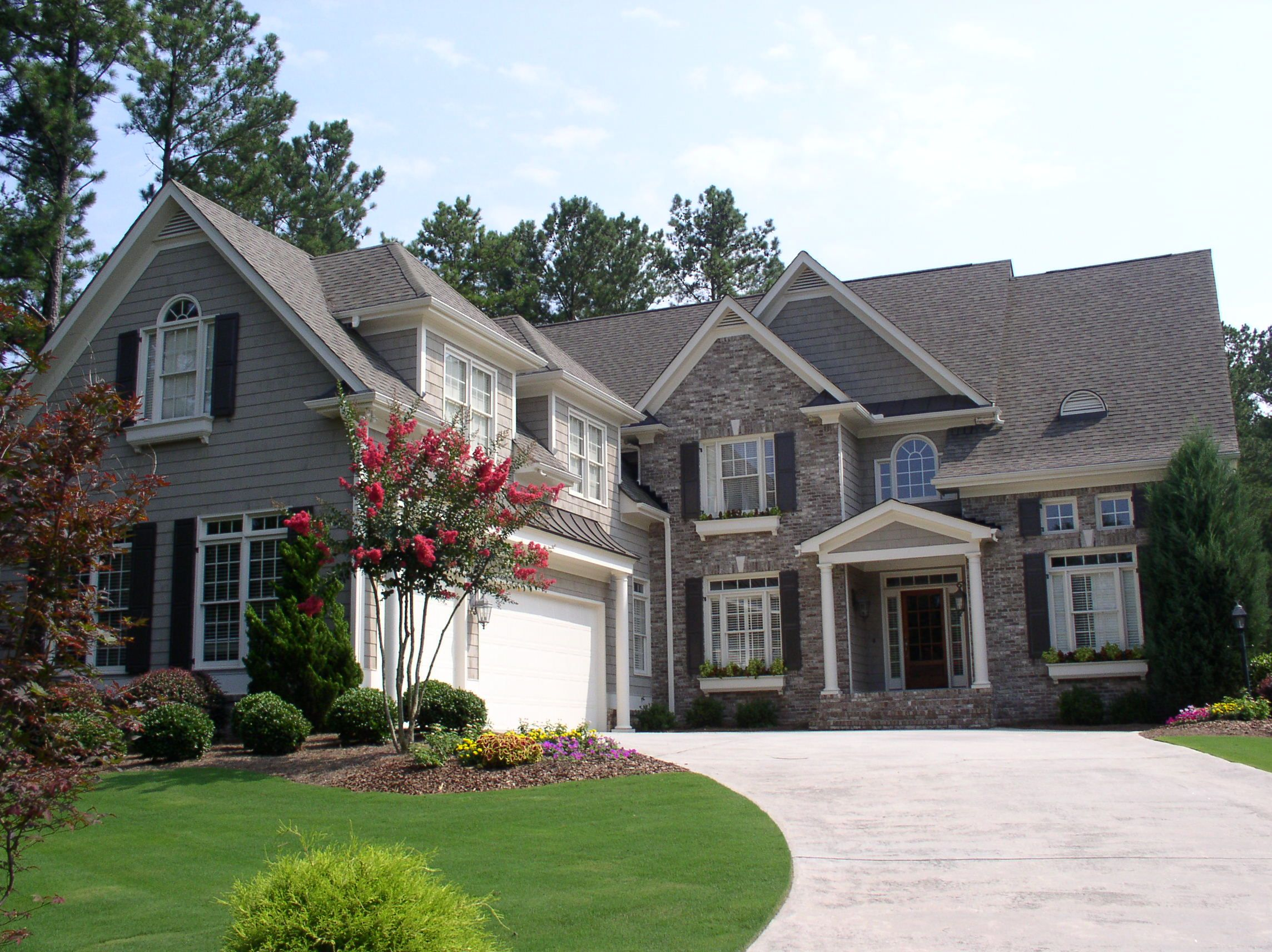 Example Of Stone Accented Home. Featured Home: Executive Home In White  Columns Country