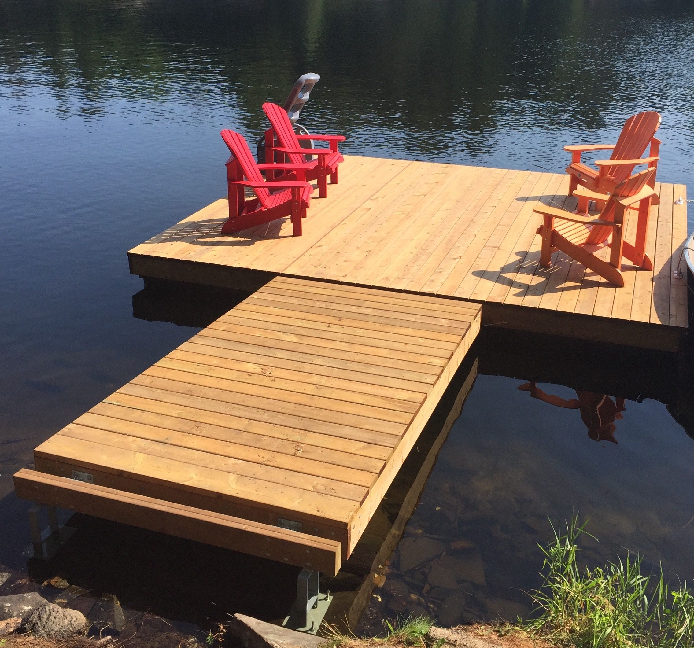 Completed floating dock and ramp with ramp secured to