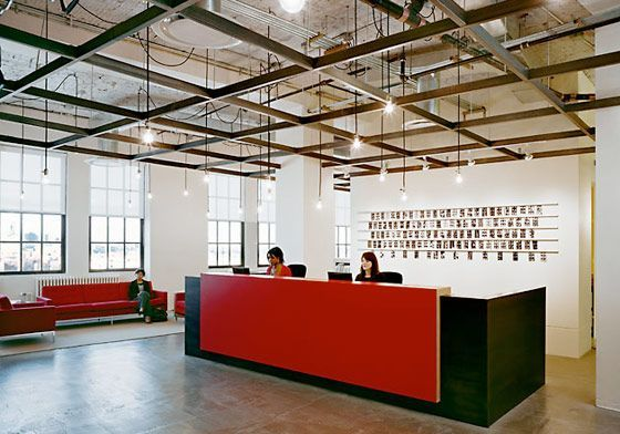 Very Cool Office Space   Simple But Stylish Lighting With Exposed Beam  Ceilings. I Like The Bright Red Reception Desk.