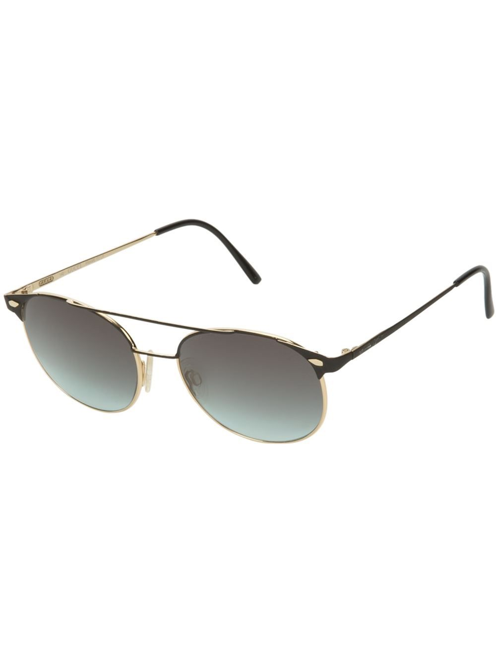 6dc874470d74d Black metal sunglasses from Gucci Vintage featuring round frames with a gold-tone  trim