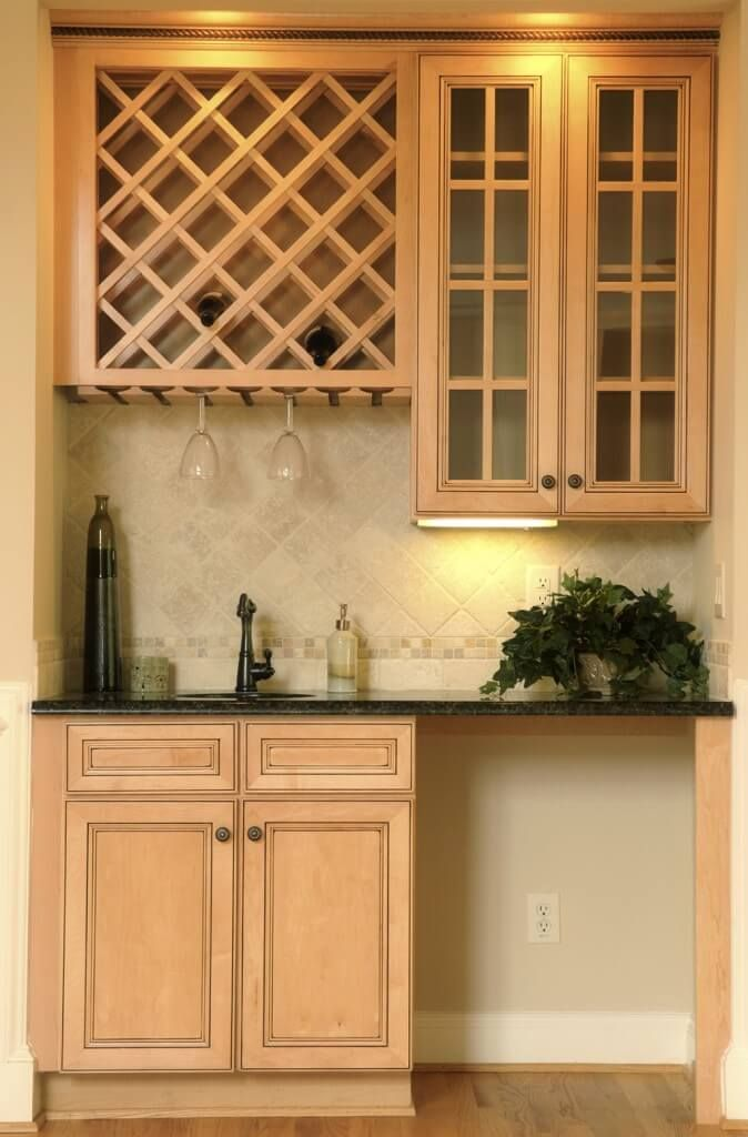 This contemporary home bar features light wood cabinetry  subtle tile backsplash and wine glass rack also incredible design ideas photos kitchen rh pinterest