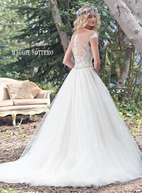 Montgomery wedding dress by Maggie Sottero | A delicate illusion off-the-shoulder neckline coupled with a dramatic illusion lace back create glamour in this alluring ball gown wedding dress with delicate lace bodice and flowing tulle skirt, accented with a feminine Swarovski crystal belt. Finished with crystal button over zipper closure.