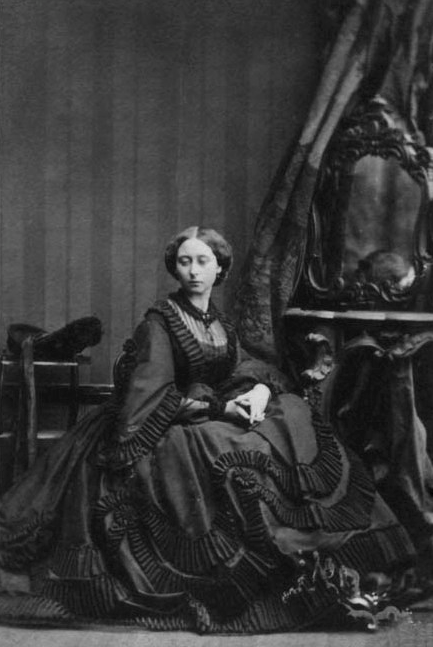 Princess Alice (1843-1878) in mourningdress. The Princess is wearing mourning for her grandmother, the Duchess of Kent, who had died four months previously. 4 july 1861. photo by Camille Silvy