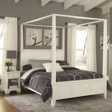 futuristic bed frame with canopy laminate flooring and white color curtains also grey walls