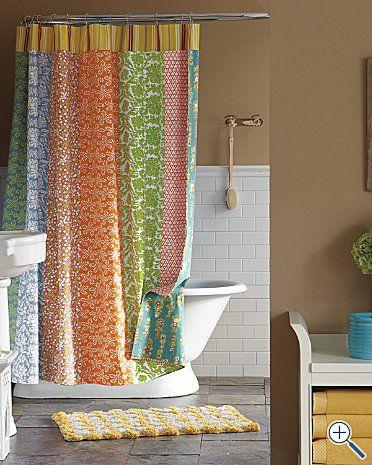 I like the idea of a paneled shower curtain. I can find ...
