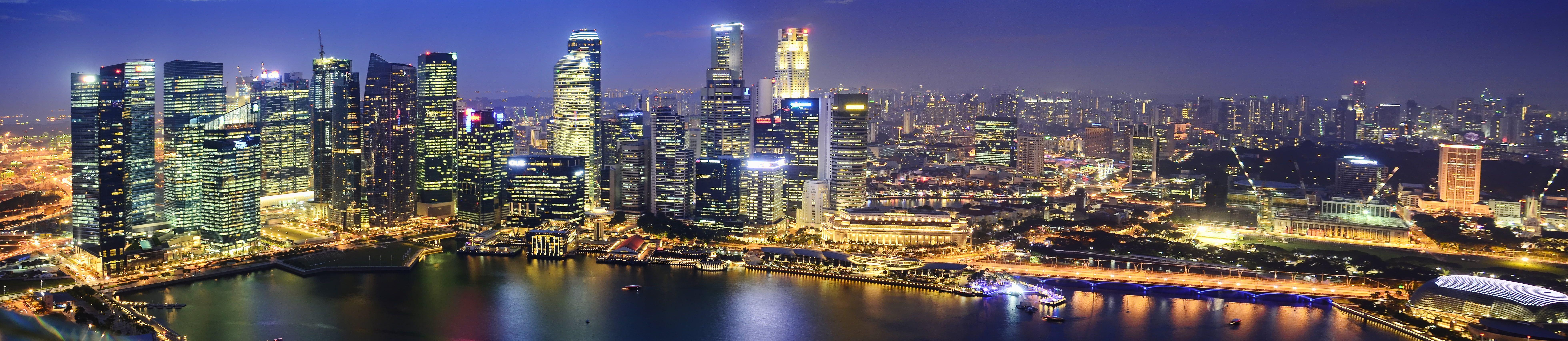 panorama photo of city near body of water during night tiem #fallwallpaperiphone