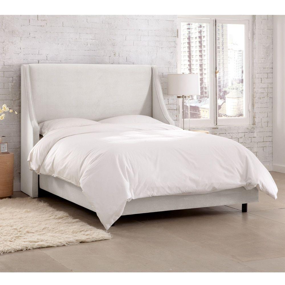 Skyline Furniture Velvet White Swoop Arm Wingback Bed