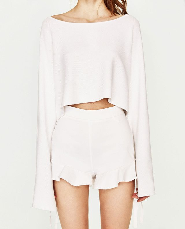 e83415cac770c ... New Music Video Has Everything You Need To Pack For Vacation -  30 Zara  High Waisted White Frilled Shorts And Matching White Long Sleeved Cropped  Top
