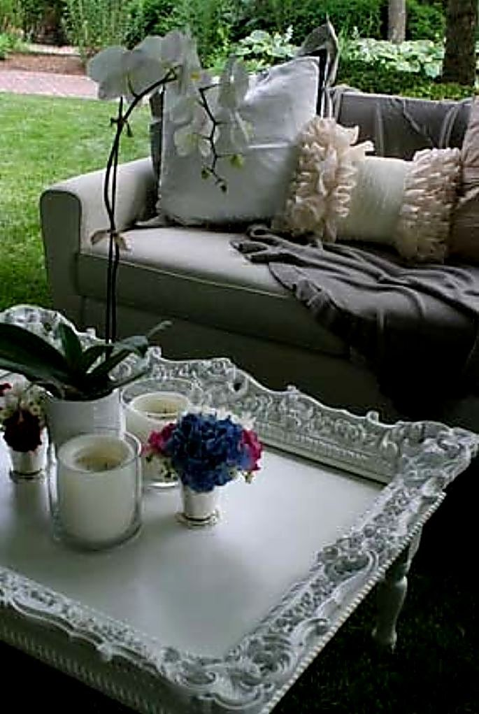 Info's : Old picture frame secured on top of coffee table, then painted same shade..... whole new look !