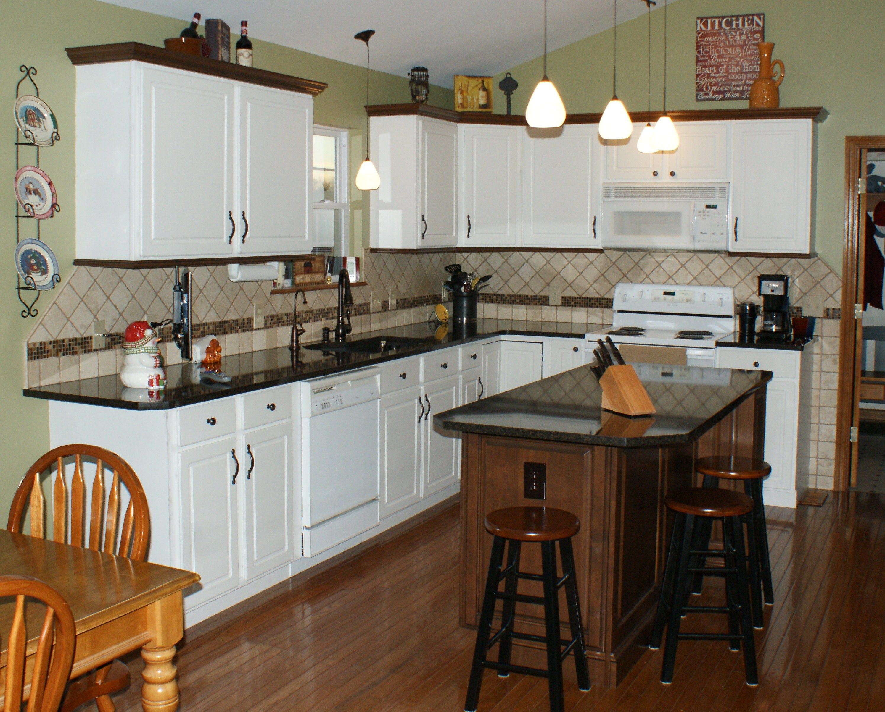 new brookhaven island nut brown on maple with matching molding added to existing white thermofoil cabinetry